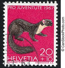 Pine marten - SWITZERLAND - CIRCA 1967: stamp printed by...