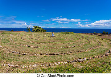 Person Sitting in Maui Labyrinth - Person meditating in...