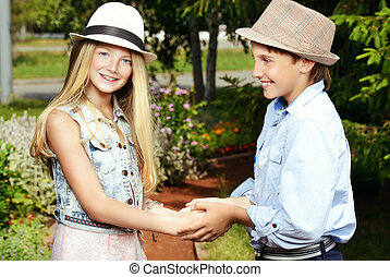 meeting - Two cheerful teenagers in the summer park...