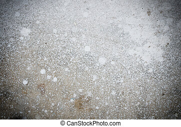 Abstract splash of white color on cement background texture