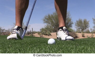 Golfer Hitting Iron Shot - a golfer hitting a shot with an...