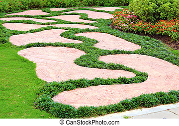 garden stone foot path with grass
