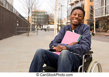 happy young disabled man in a wheelchair holding folders