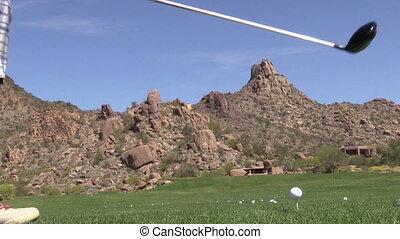 Golfer Teeing Off - a golfer hitting a drive