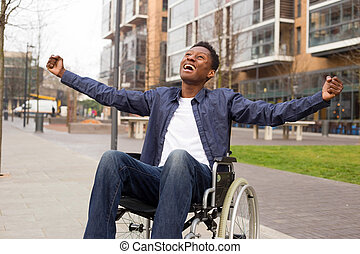 a young wheelchair user celebrating