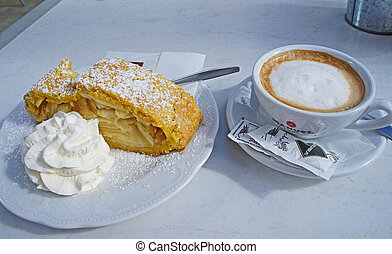 Cappuccino and apple strudel - A place setting with a cup...
