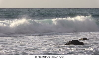 California Coastal Waves - waves crashing ashore along the...