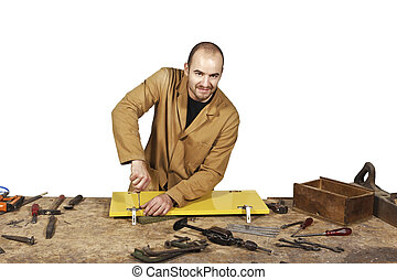 carpenter on white - craftsman at work isolated on white...