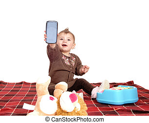 Baby holding up a cell phone. - A little baby girl sitting...