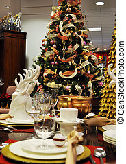 christmas eve - christmas dining table with christmas tree...