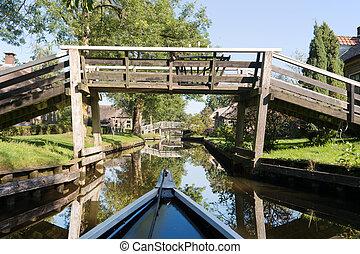 With boat in Dutch village - Dutch village Giethoorn with...