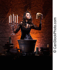 Young sexy witch making the witchcraft in the dungeon
