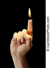 Candle finger - Hand with a finger that burns like a candle