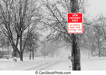 Snow Route - Red and white snow route sign against a black...