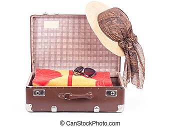 Open vintage suitcase with clothing isolated on a white