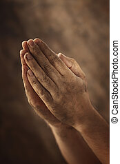 Humble prayer - Dirty hands clasped together for a prayer