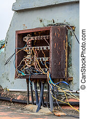 Indian chaotic electrical wiring on the roof at...