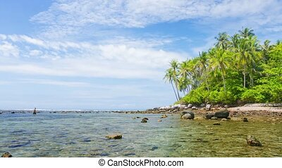 Man Wading in Shallows along Wild Tropical Beach in Thailand...
