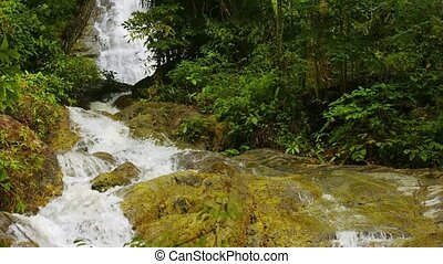 Whitewater Cascading over a Natural Waterfall in Thailand,...
