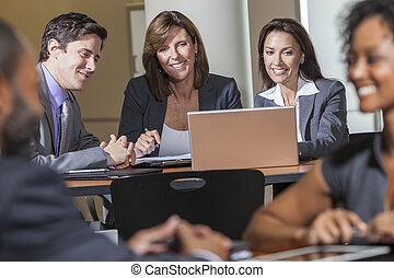 Business Team Using Laptop Computer in Meeting - Male and...