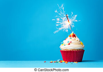 Cupcake with sparkler on blue - Cupcake with sparkler...