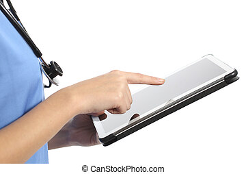 Side view of a nurse or doctor hand using a tablet isolated...