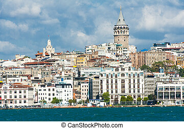 Galata Tower over the Golden Horn in Istanbul, Turkey seen...