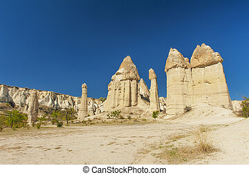 Fairy tale chimneys in Love Valley near Goreme, Cappadocia,...