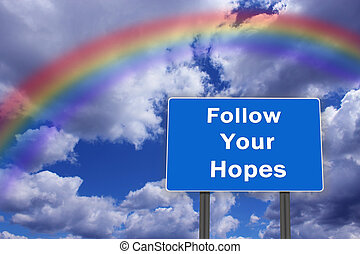 Billboard with inscription Follow Your Hopes on the...