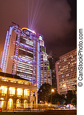 Night scenes of skyscraper with rays in Hong Kong - It is...