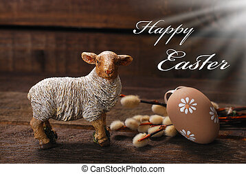 easter rustic decoration with lamb and egg on wooden...