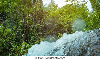 Water Splashing over Rocks in a Natural Spring in Thailand -...
