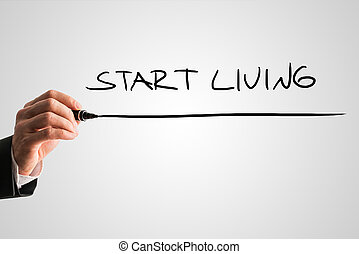 Start living - Man writing the words - Start living - with a...
