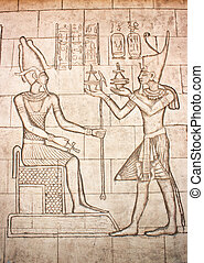 Old murals. Frieze of Egyptian Goddess. Wall carving.
