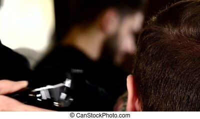 Barbershop: the wizard cut close up Mens haircut in a...