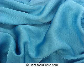 Wrinkled shiny blue fabric