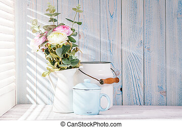 Morning still life on shabby chic table and light from the...