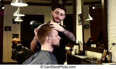 Stylish interior: Barber dries client hair - Stylish...