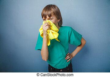 Boy, teenager, twelve years in a green t-shirt ,...