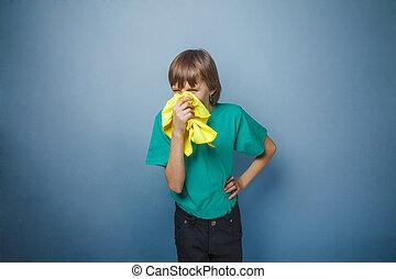 Boy, teenager, twelve years in a green t-shirt, handkerchief...