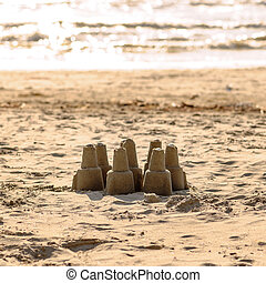 Sand castle - leisure activity at the beach