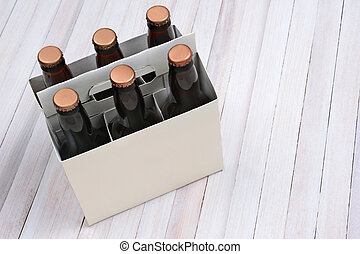 Blank Six Pack on Wood Table - High angle shot of a blank...