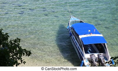 motor tourist speed boat tied up at sea coast - motor...