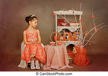little princess tea party on Valentines Day - girl in a red...
