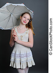 12-13 years girl under an umbrella - smiling girl 12-13...