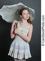 12-13 years girl under an umbrella - smiling girl 12-13...