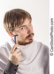 Young man holding a razor