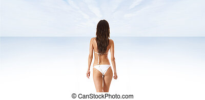 Sexy back of young beautiful brunette isolated on white