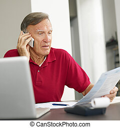 Senior man checking home finances. Copy space