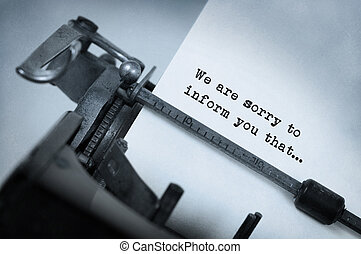 Vintage inscription made by old typewriter, We are sorry to...